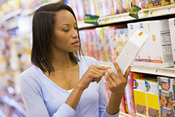 Woman Reading Product Label
