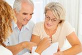 older white hetro couple with financial planner