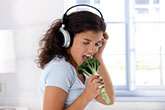 Woman using Broccoli stalk like a Mic