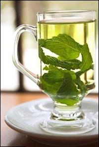 clear glass mug of Green Tea leaves