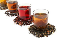 Assortment of leaves and brewed Teas
