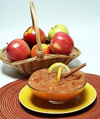 Apples in a basket and a bowl of applesauce