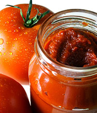 Tomatoes and jar of Tomato Paste