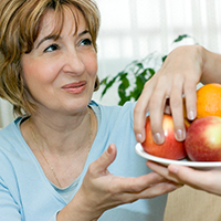 Woman Taking Fruit from bowl