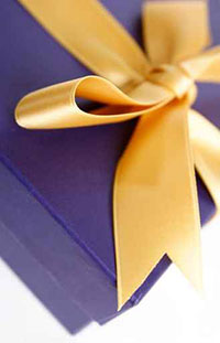Gold Bow on a Purple Box