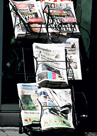 News rack with papers
