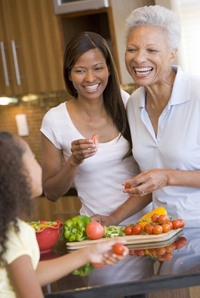 3 generations of black women cooking