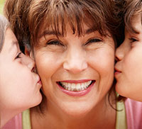 Grandmother being kissed by 2 Kids