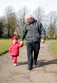 Older Man walking with little Girl