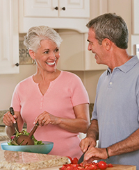 Older White Couple Cooking