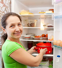 Woman in front of open refrigerator