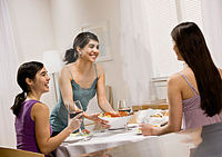 3 women eating together