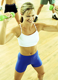 Fit Blond Woman with Green Weights