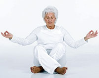 older woman practicing yoga