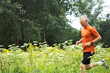 Older Man Running Through Flowers