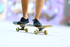 Skateboard and shot of Female Legs