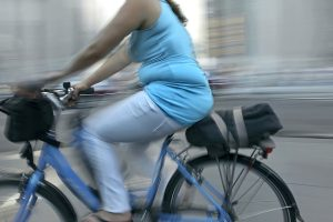 bigstock-overweight-woman-riding-bicycl-21670745