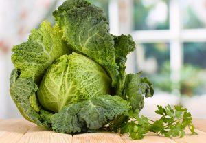 bigstock-Fresh-savoy-cabbage-on-wooden--38568460