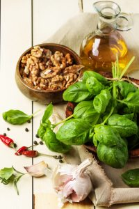 http://www.dreamstime.com/royalty-free-stock-photography-basil-nuts-olive-oil-bunch-fresh-bowl-walnuts-pepper-garlic-glass-bottle-served-white-wooden-table-see-series-image36664137