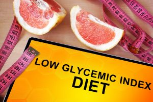 low glycemic index sign with grapefruit wedges and tape measure on table