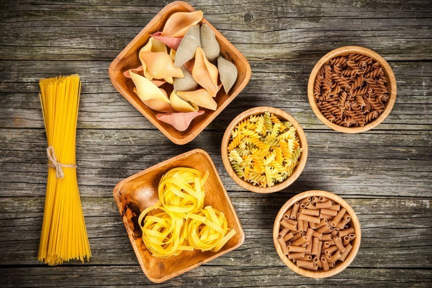 41837375 - different types of pasta on wooden background