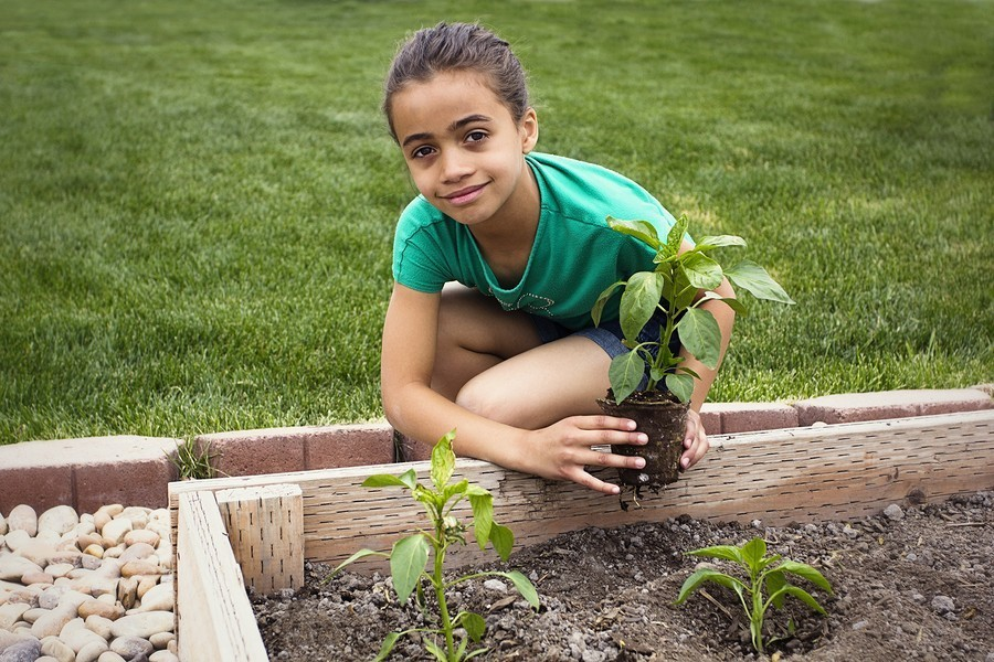 girl planting in her garden